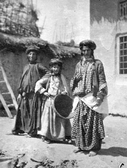 Photograph of three Kurdish jewish family members from the the small town of Rowndiz in the Kurdish mountains in northern Iraq