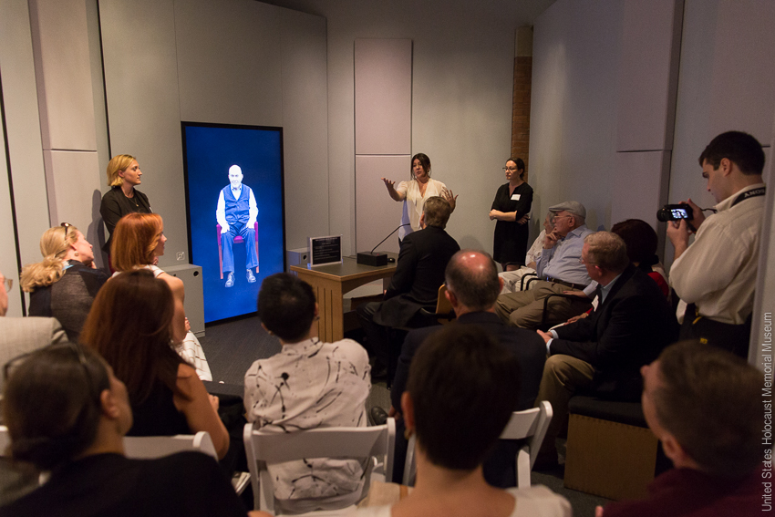 Staff from USC Shoah Foundation as well as Holocaust Survivor Pinchas Gutter visit the New Dimensions in Testimony display. Photo Credit:U.S. Holocaust Memorial Museum