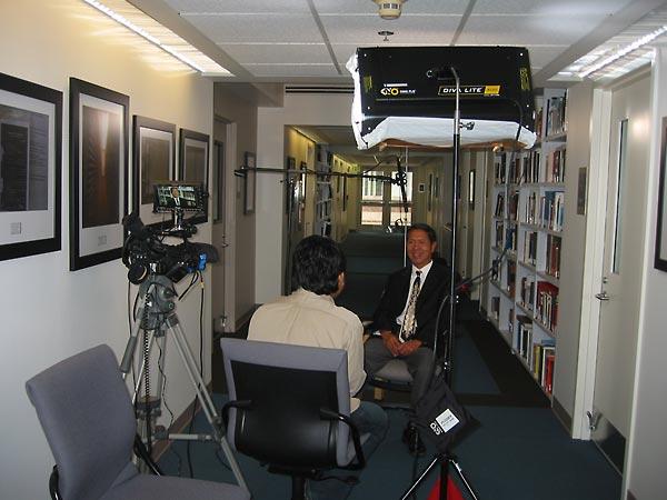 Ratanak Leng (left) interviews survivor Danny Vong at the Institute.