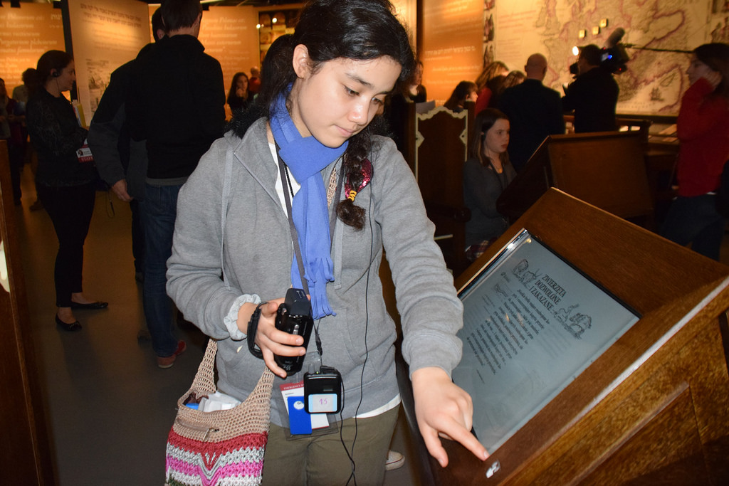 Ruth Hernandez, 15, looks at an exhibit at the Museum of the History of Polish Jews. Hernandez was the winner of the first USC Shoah Foundation's IWitness Challenge in 2014. (USC Photo/Josh Grossberg)