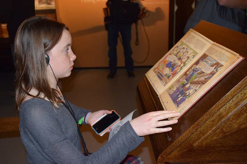 Clair Denault, 13, looks at a display at the Museum of the History of Polish Jews. (USC Photo/Josh Grossberg)