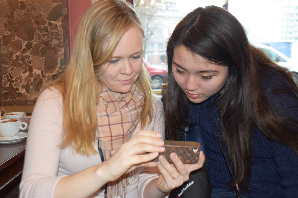 Deanna Pitre (left), social media coordinator for USC Shoah Foundation, and 17-year-old Natalia Smith look at selections at E. Wedel chocolate store in Warsaw. (USC Photo/Josh Grossberg)