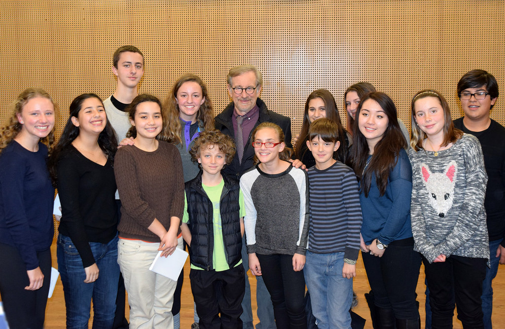Members of the USC Shoah Foundation Junior Intern program meet with USC Shoah founder Steven Spielberg in Warsaw. (USC Photo/Josh Grossberg)