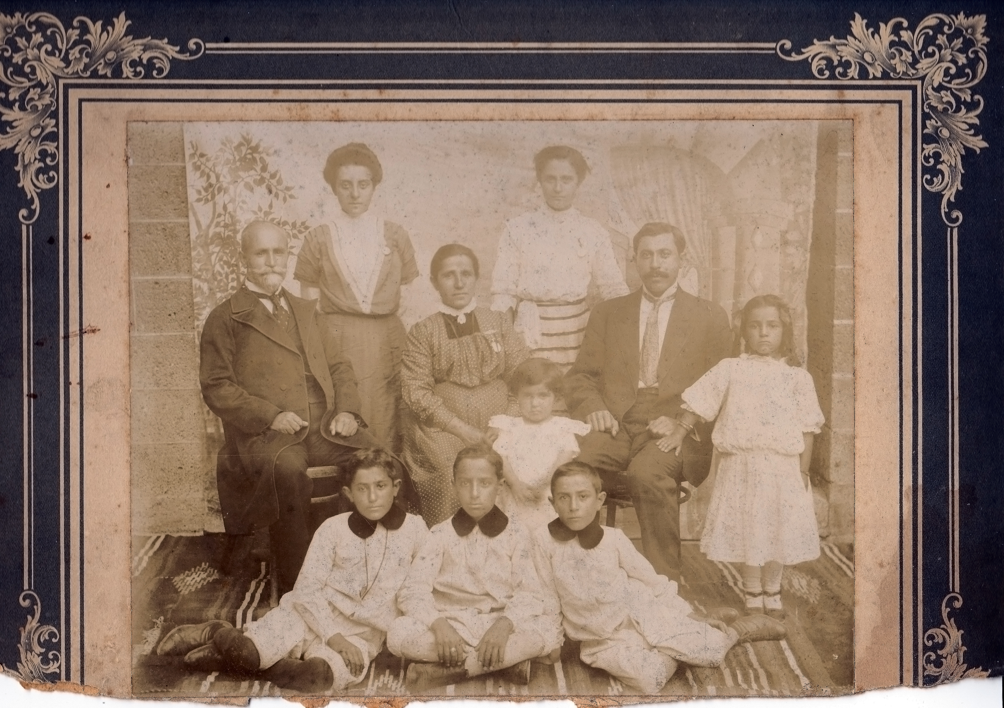 Muggerditchian family in 1911. Thomas is seated far left