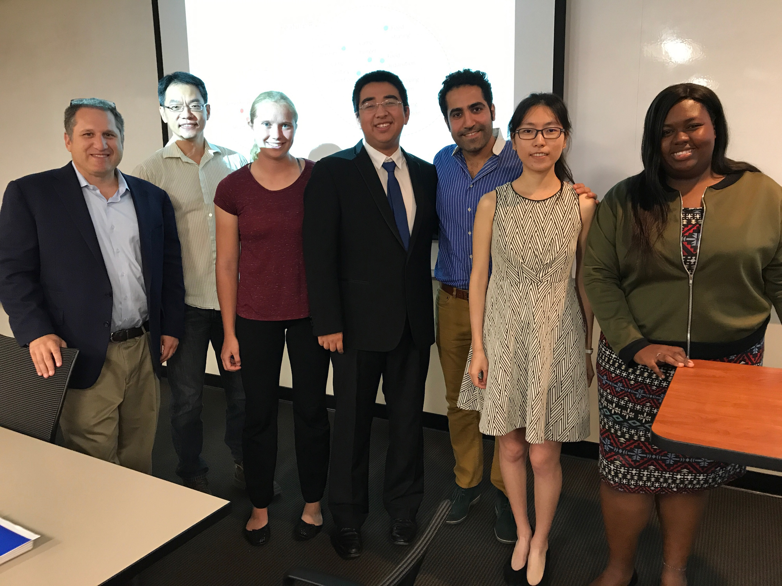 Sam Gustman and Mills Chang, left, and the group with advisor Ehsan Ebrahimzadeh (third from right)