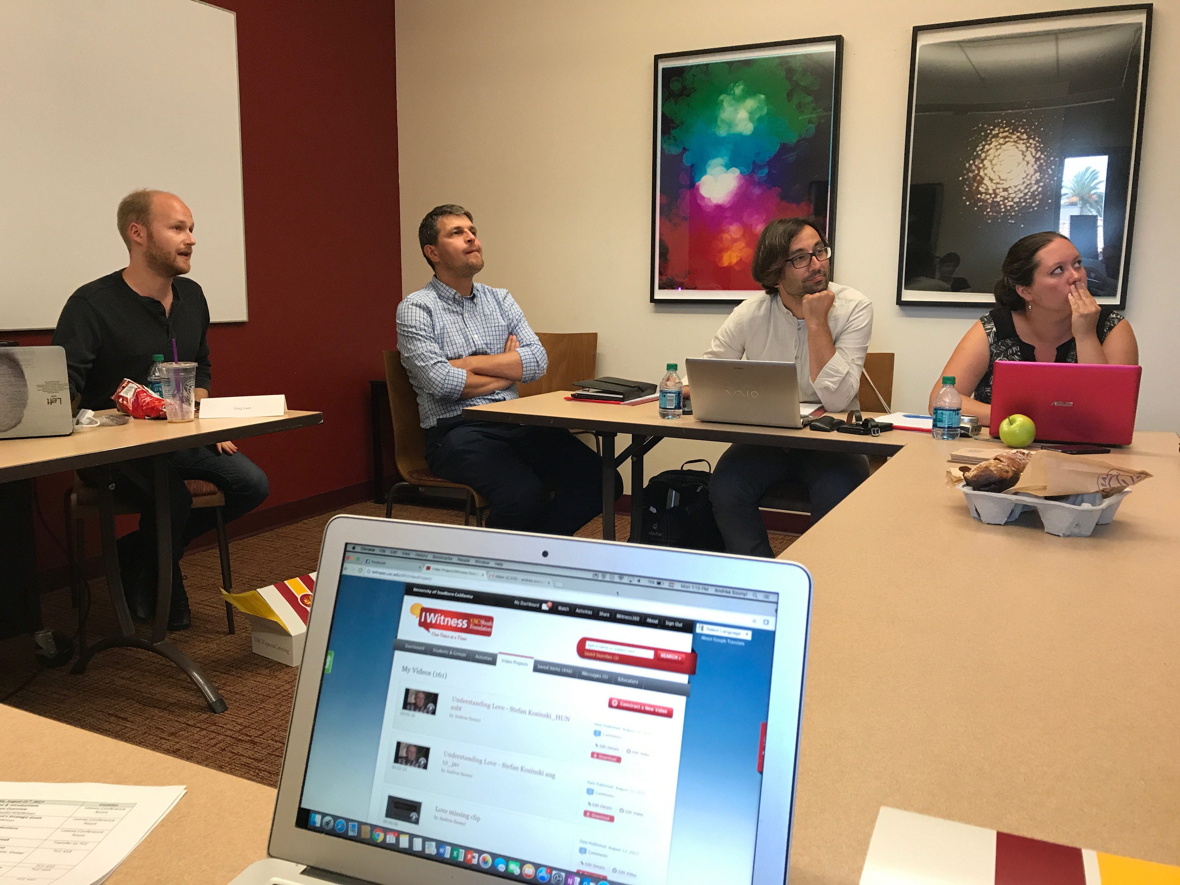 Greg Irwin, left, leads a session on IWitness