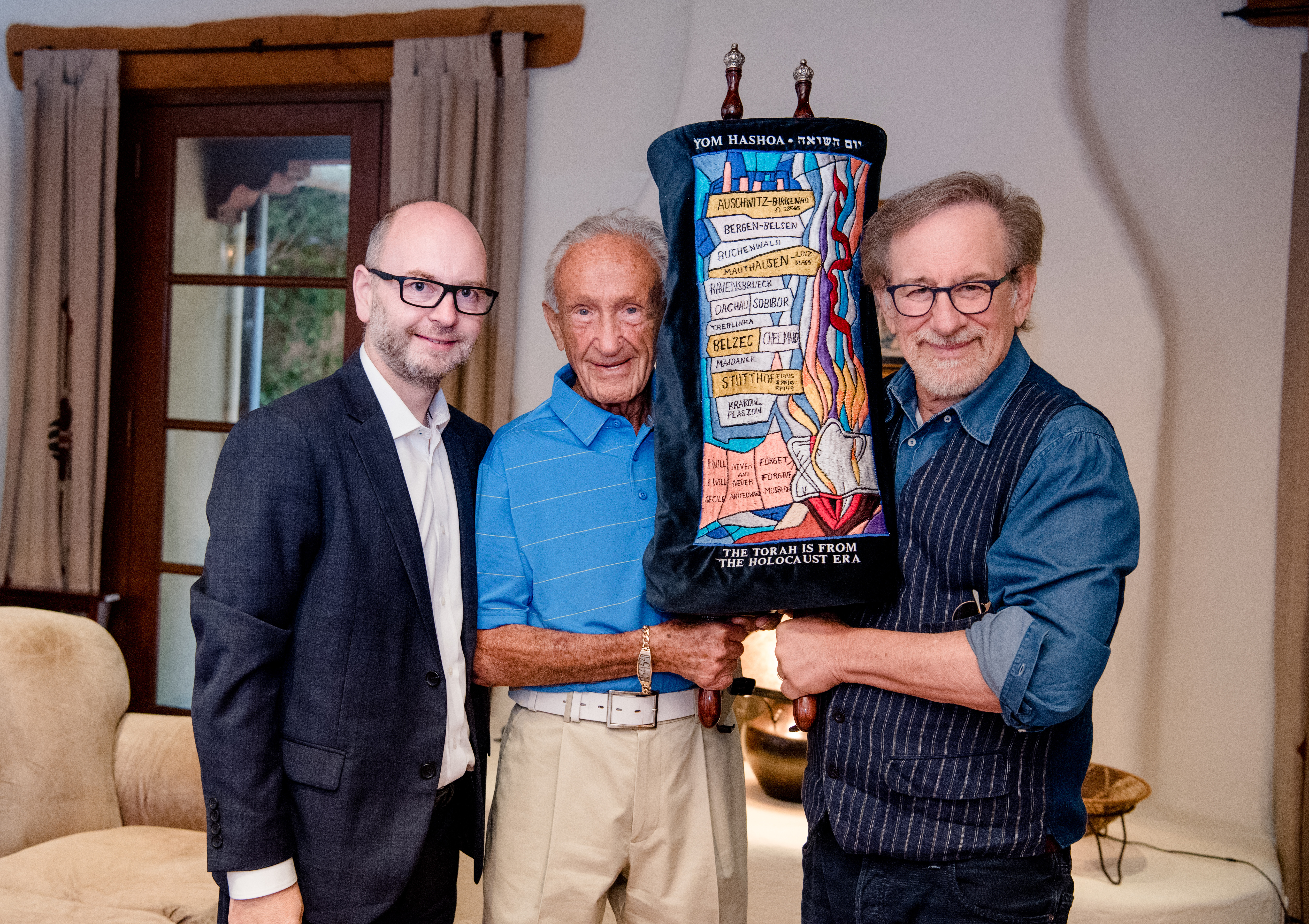 Stephen Smith, Ed Mosberg and Steven Spielberg with the Torah donated by Mr. Mosberg