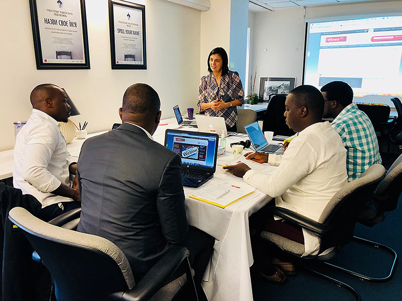 Members of the education team from Aegis Trust discuss creating IWitness activities with Lesly Culp, the Institute's head of educational programs. The visitors are, from left to right: Marc Gwamaka, Jean Nepo Ndahimana, Pierre Claver Irakoze and Enoch Ssemuwemba.