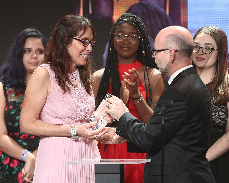 Ivy Schamis, Marjory Stoneman Douglas High School history teacher, receiving the 2018 Stronger Than Hate educator award