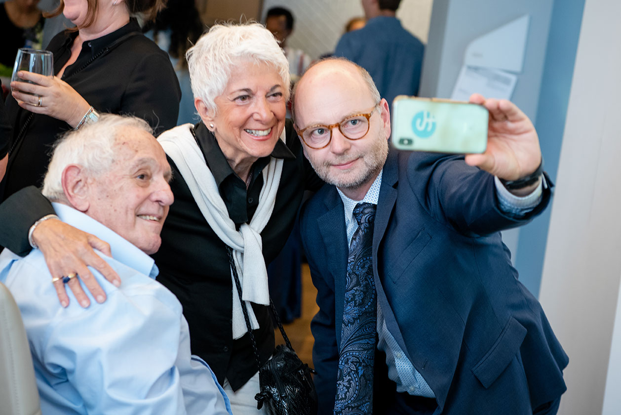A selfie with George Weiss (seated), Daisy Miller and Finci-Viterbi Executive Director Stephen Smith