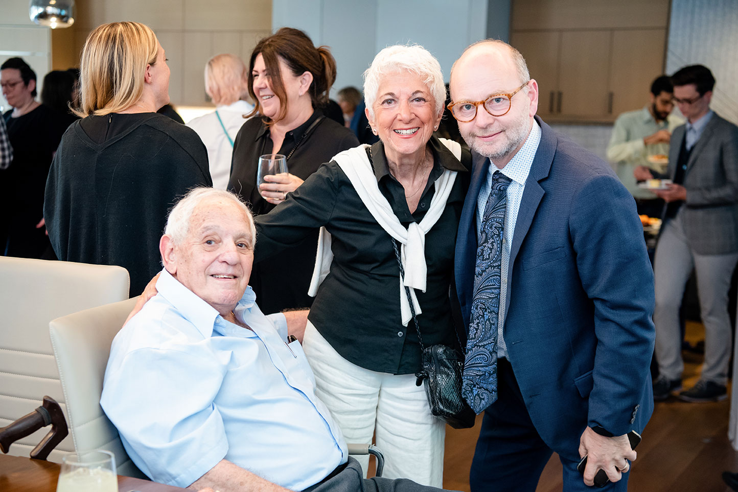 George Weiss (seated) with Daisy Miller and Finci-Viterbi Executive Director Stephen Smith