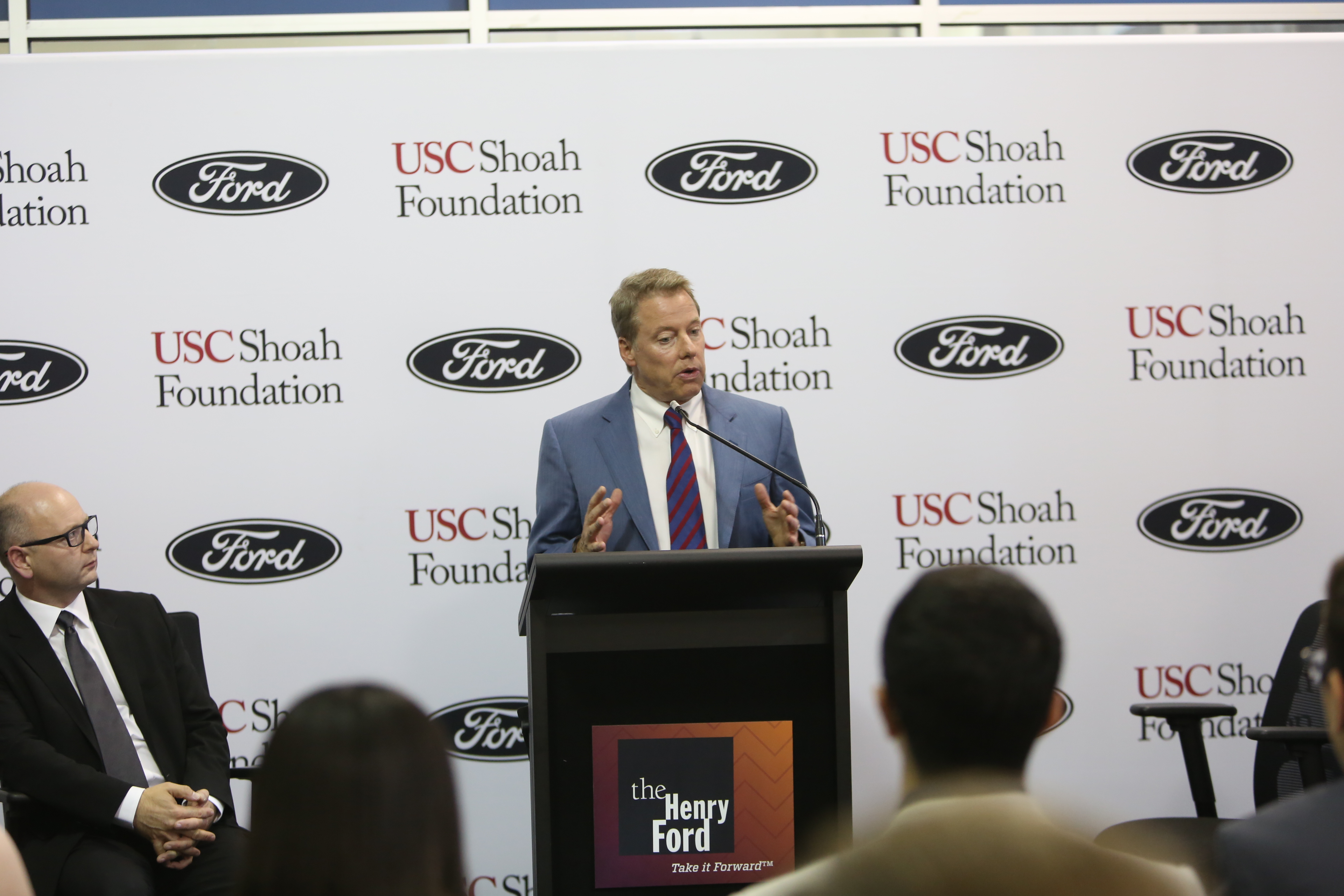 Bill Ford announces Ford's partnership with IWitness Detroit  at a press conference before the gala