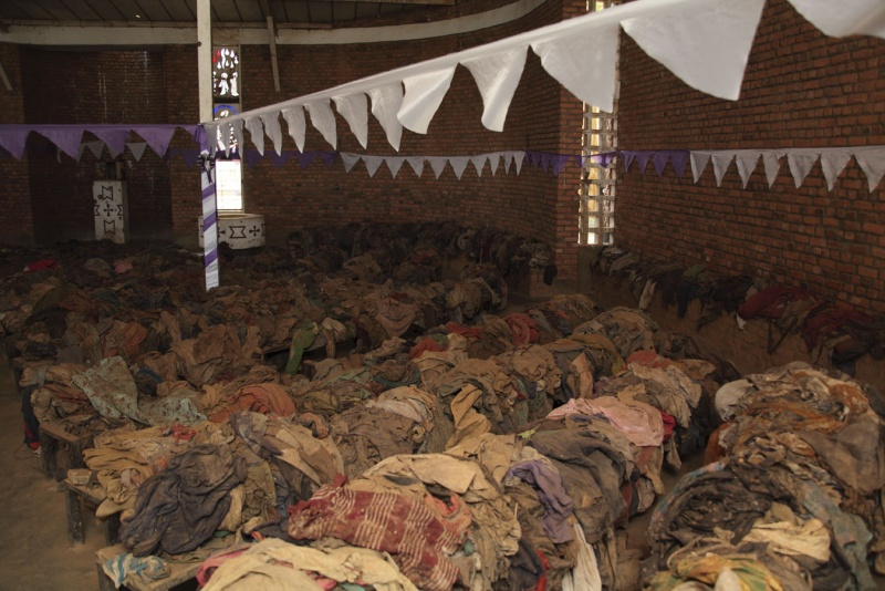 Interior photograph of Nyamata Church depicting the piles of victims' clothing placed on the pews.