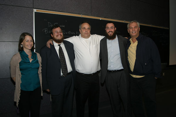 Zvi Bielski (center) posing with Chabad representatives and Sonya Sharp from the Institute (first from the left).
