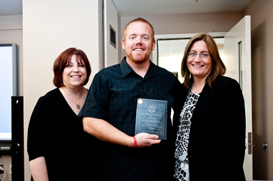 With Sherry Bard, Institute Project Director of Educational Programs (left), and Sheila Hansen, Institute Senior Trainer and Content Specialist (right), Jonathan Owens, a teacher at Valhalla High School in San Diego, proudly displays his award.