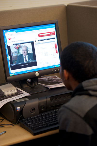 Student watches a testimony online via IWitness.