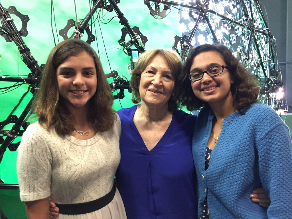 Fritzie Fritzshall posing with student during filming for Dimensions in Testimony