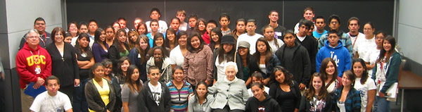 Group photo taken with students from GEAR UP, with Holocaust survivor Renée Firestone.