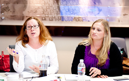From left:  Merri Weir and Teresa Hill share their experiences with using testimony in their classrooms over the past year.