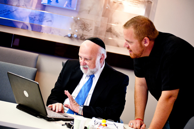 Yisroel Blumenstein (left) and Jonathan Owens viewing a presentation that Yisroel developed for his class using testimony from the Institute's Visual History Archive.