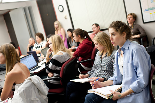 USC students thoughtfully listen to Wendy Lower's presentation and take notes.