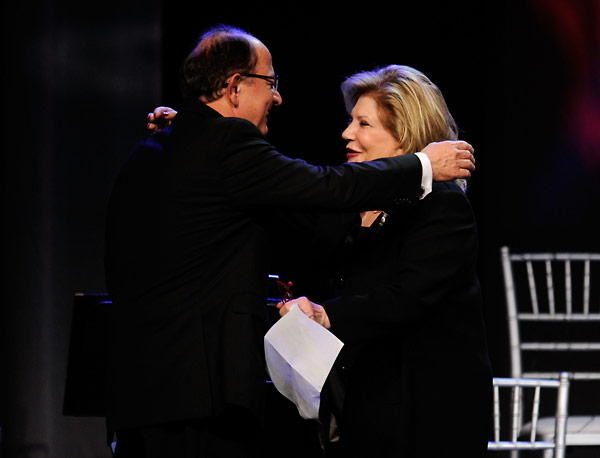 USC President L. Max Nikias greets Wallis Annenberg on the stage at the 2010 Ambassadors for Humanity Gala in honor of Jeffrey Katzenberg.