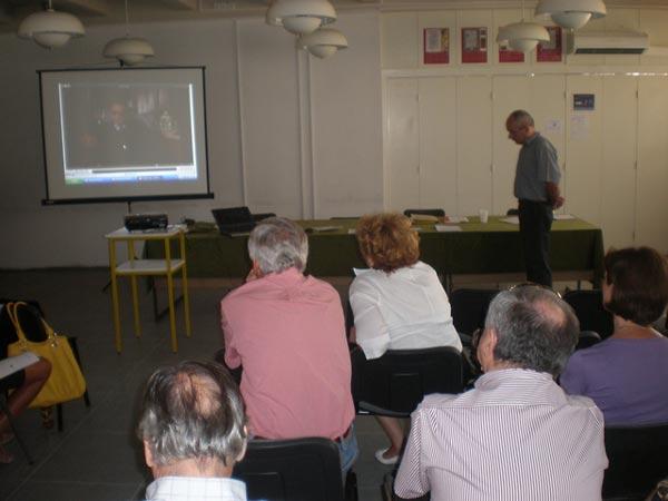 Participants at a teacher training seminar watch testimony during a workshop session led by lesson author Miroslav Šašić.