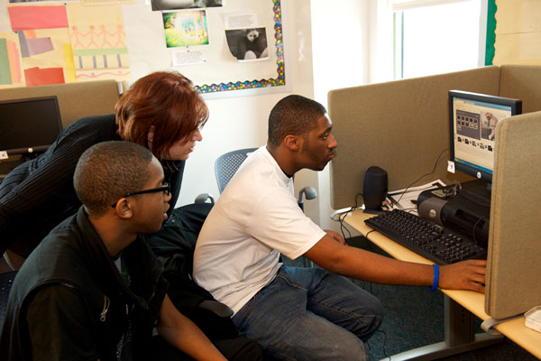 Sherry Bard, the Institute's Educational Programs, Project Director, works with students on their media projects.