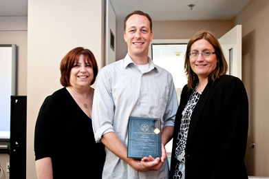 Jeremy Howard (center), an educator at Francis Parker Middle School in San Diego, with plaque in honor of completing a testimony-based project, by Sherry Bard, Institute Project Director of Educational Programs (left), and Sheila Hansen, Institute Senior Trainer and Content Specialist (right).
