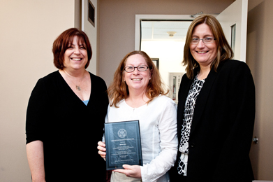 With Sherry Bard, Institute Project Director of Educational Programs (left), and Sheila Hansen, Institute Content Specialist (right), Merri Weir (center), an educator at Carson High School, holds up her recognition award for the completion of a testimony-based project.