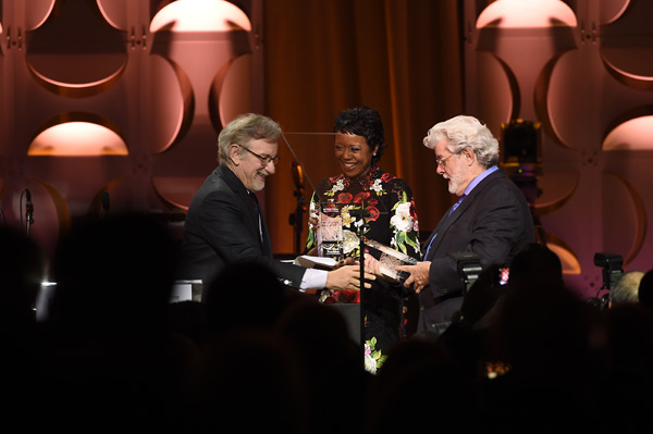 Steven Spielberg giving the Ambassor for Humanity award to Mellody Hobson and George Lucas