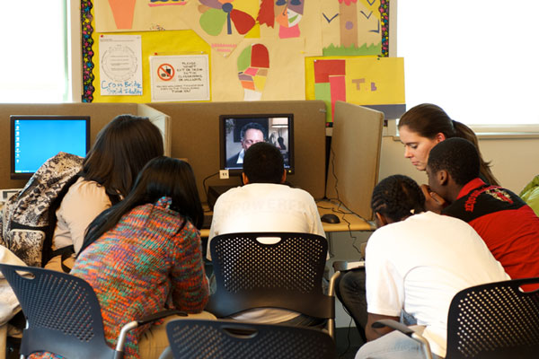 Students watch survivor testimony in IWitness.