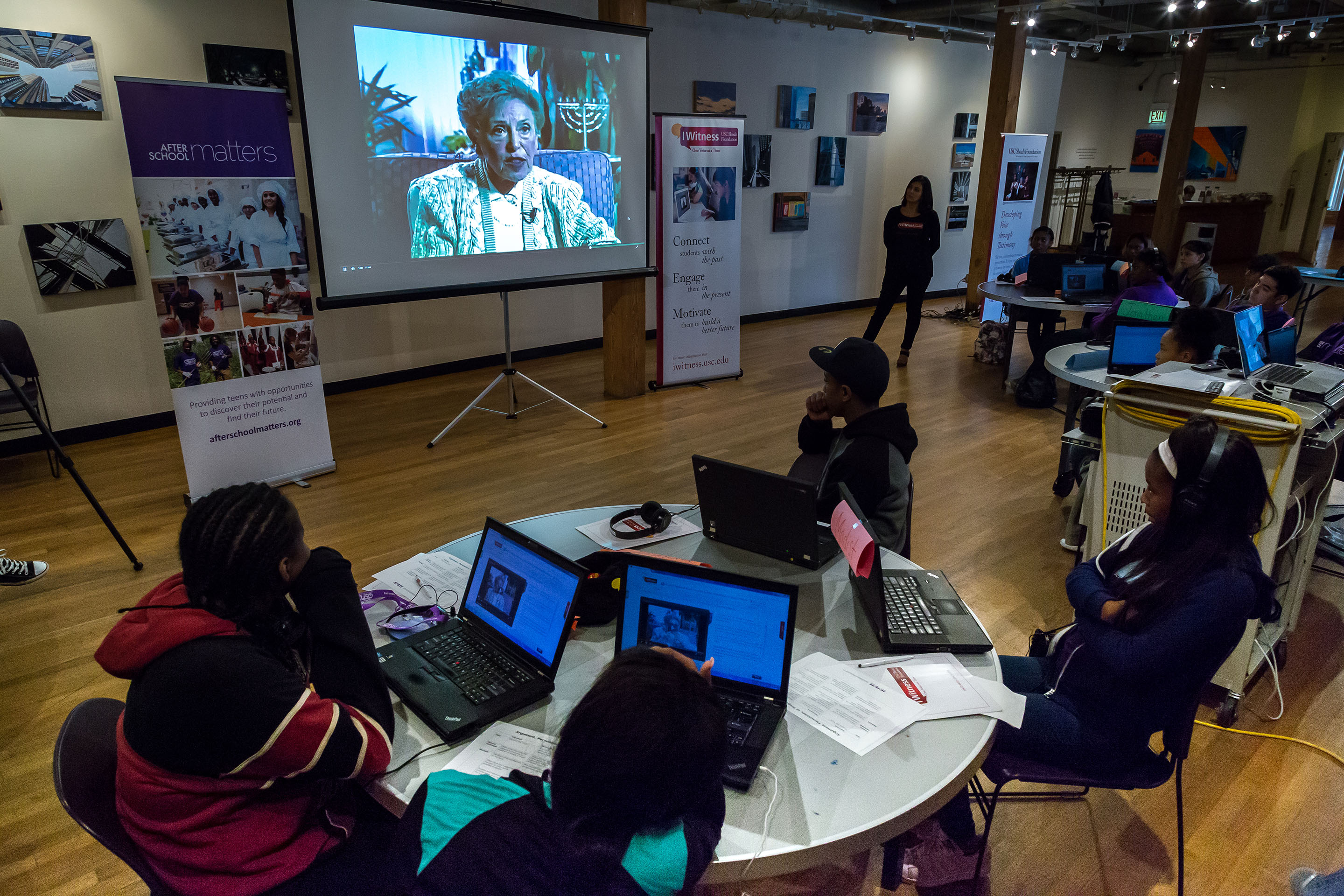 Students watch testimony as part of the IWitness activity