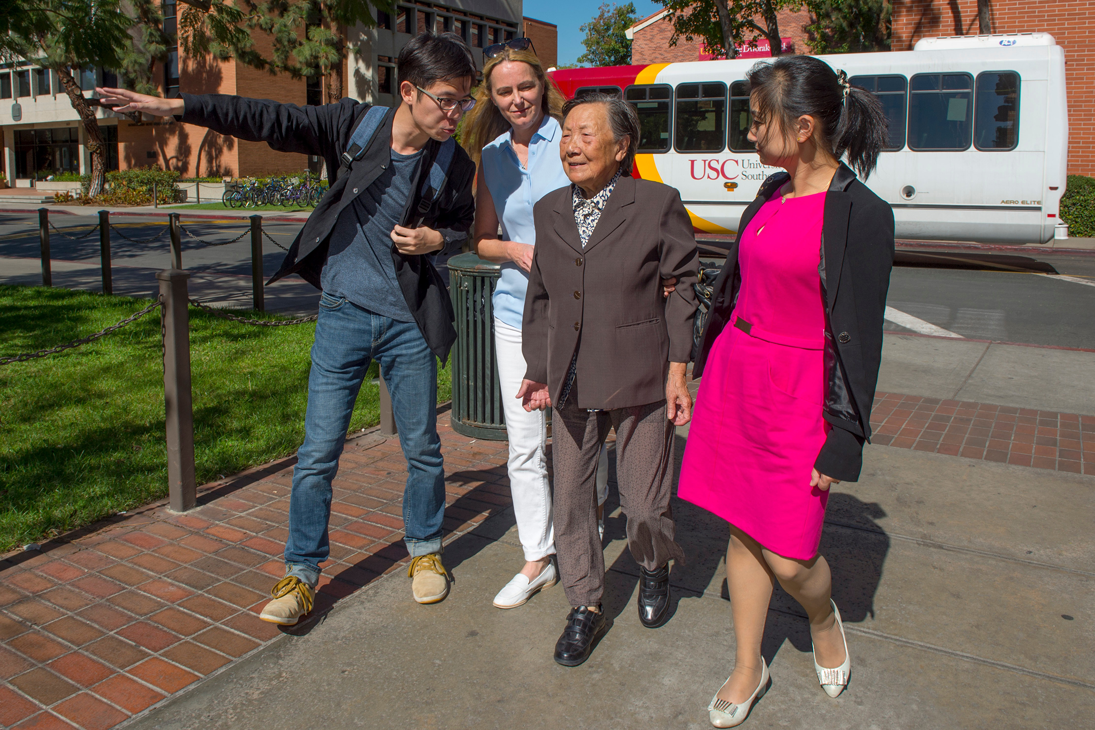 Cheng Fang, left, points out the USC campus to Madame Xia, second from right