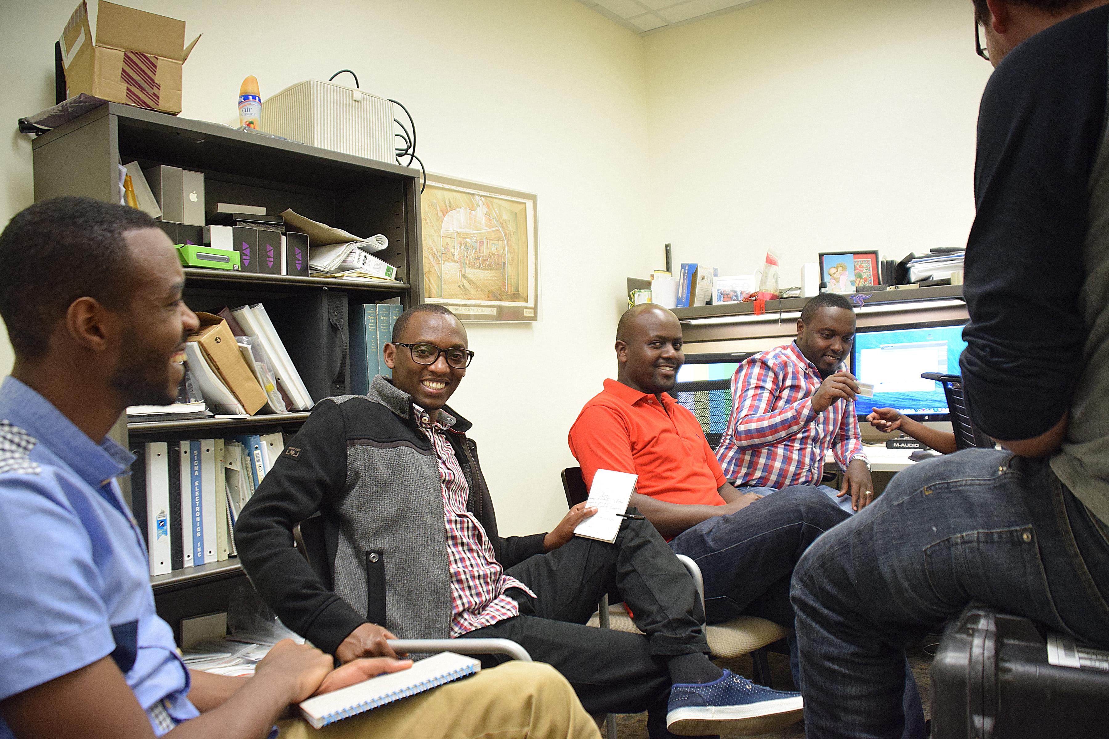 L-R: Digital Officer Fabrice Musafiri, Camera Operator Patrick Nkubana, IT Specialist Clement Muhire, Claver Irakoze, talk with Consolee