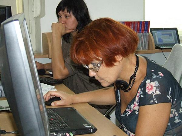 Teachers Natalya Golosova and Ruslana Burova work with video testimonies in the USC Shoah Foundation Visual History Archive.