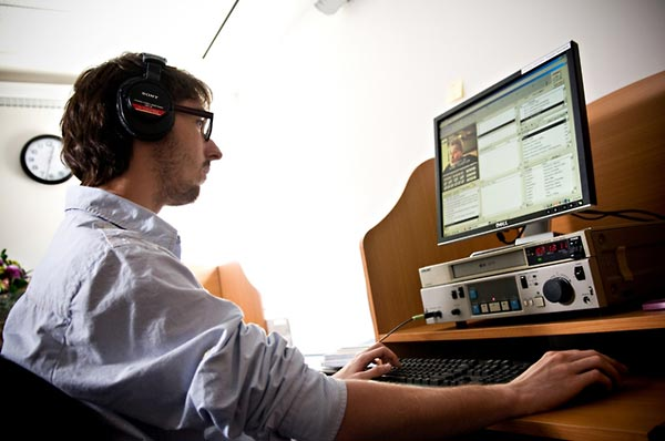Manuel Rusch, an intern from Austria, training before he begins work on indexing the remaining German language testimonies to be indexed (2009).