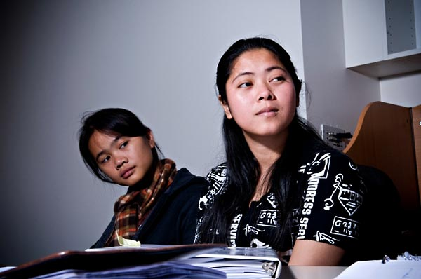 Bunthy Chey (left) and Fatily Sa (right), interns from the Documentation Center of Cambodia (DC-Cam), attending a training session on indexing video testimony (2009).