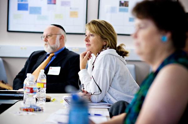 Debbie Neel (center) and Yisroel Blumenstein (rear, left), educators from San Diego- and Los Angeles-area schools.