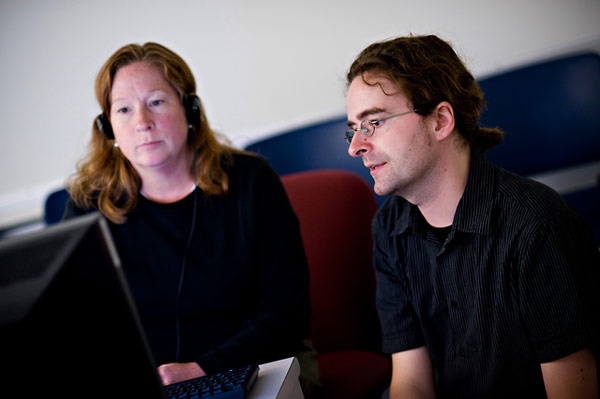 Merri Weir (left), a Los Angeles school teacher, works with Crispin Brooks (right), Curator of the Institute's Visual History Archive.