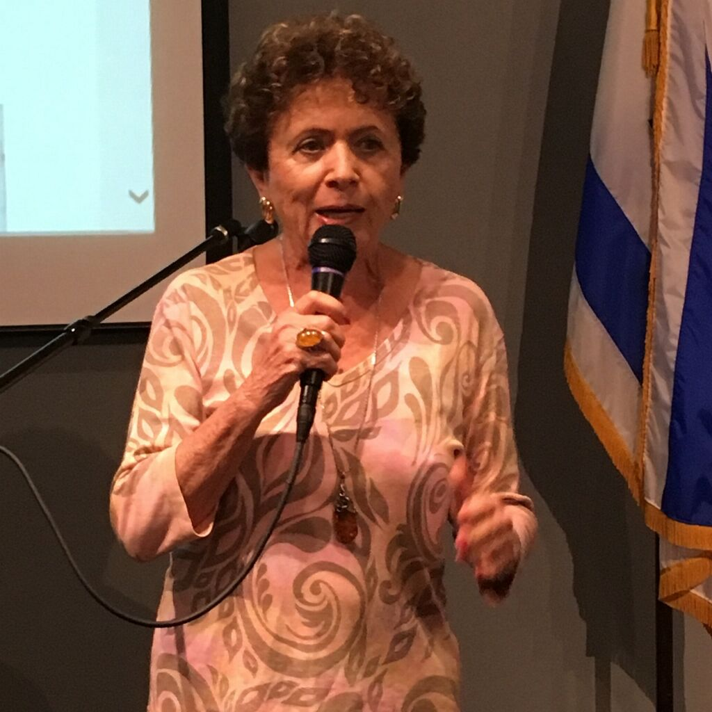 Holocaust survivor Orene Miller speaks to the group