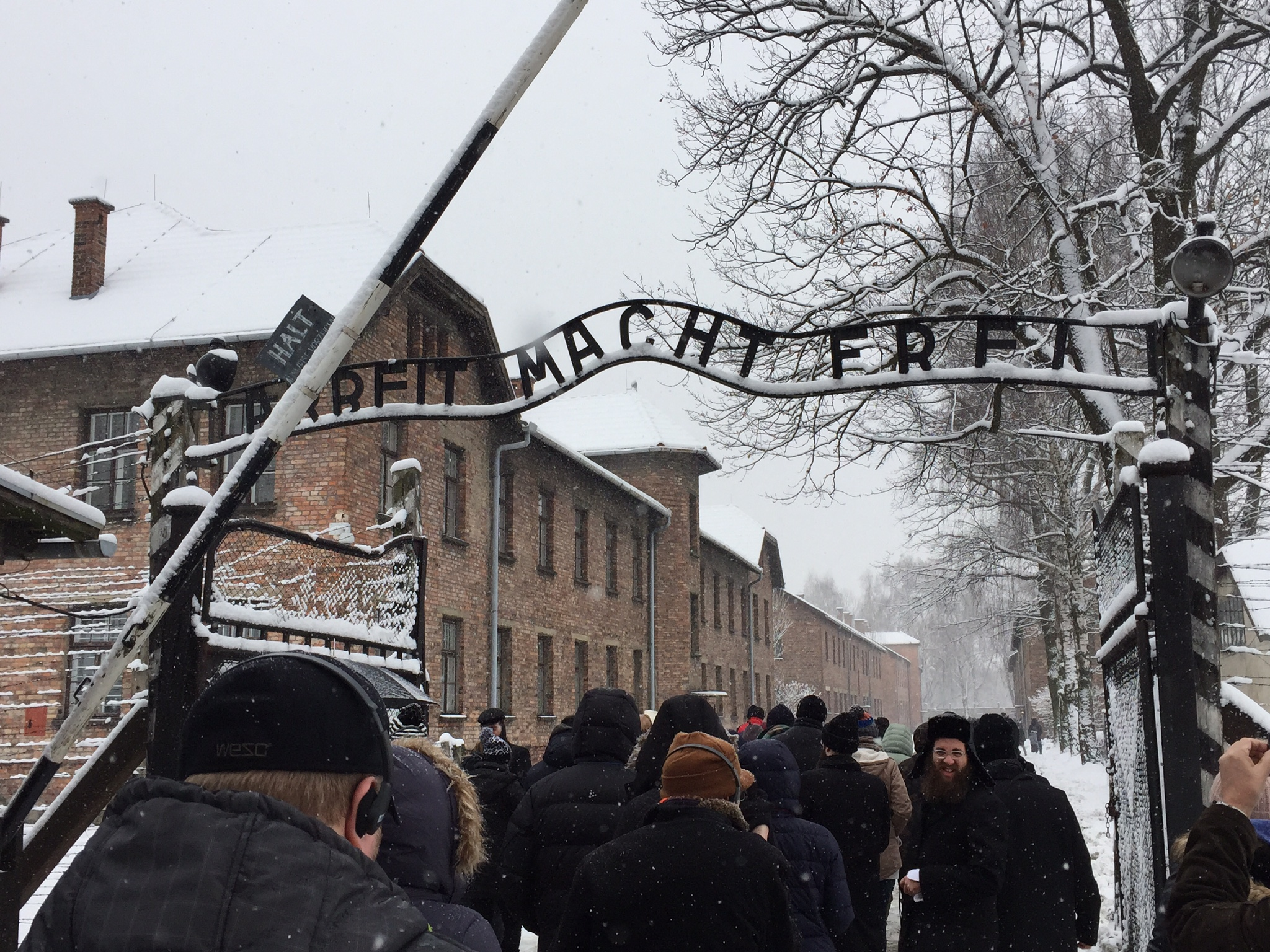 Our tour group walks underneath the infamous gate at Auschwitz I.