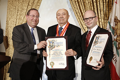 Councilmember Paul Koretz presents certificates to Andew Viterbi, center, and Stephen Smith, right