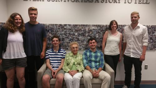My grandmother Celina (center) with my brother on the left, me on the right and fellow interns and staff.