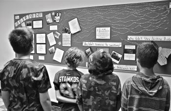 My students looking over the poster they created for our course on the Holocaust.