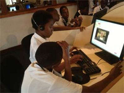 Students in Rwanda using IWitness, the Institute's online educational website