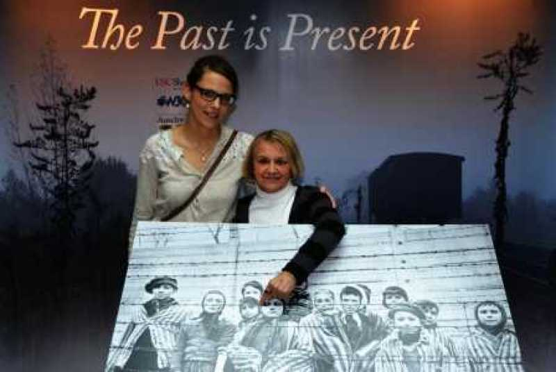 My friend and Holocaust survivor Paula Lebovics with the famous photo of her and other children after the liberation of Auschwitz in 1945.