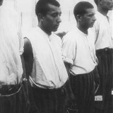 Romani (Gypsy) prisoners line up for roll call in the Dachau concentration camp. Germany, June 20, 1938. Photo credit: Bundesarchiv, Bild 152-27/11A/Foto: Friedrich Franz Bauer