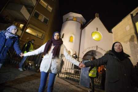 Muslims in Norway form protective ring outside a synagogue in Oslo on Feb. 21, 2014. Photo Credit: REUTERS/Hakon Mosvold Larsen/NTB Scanpix