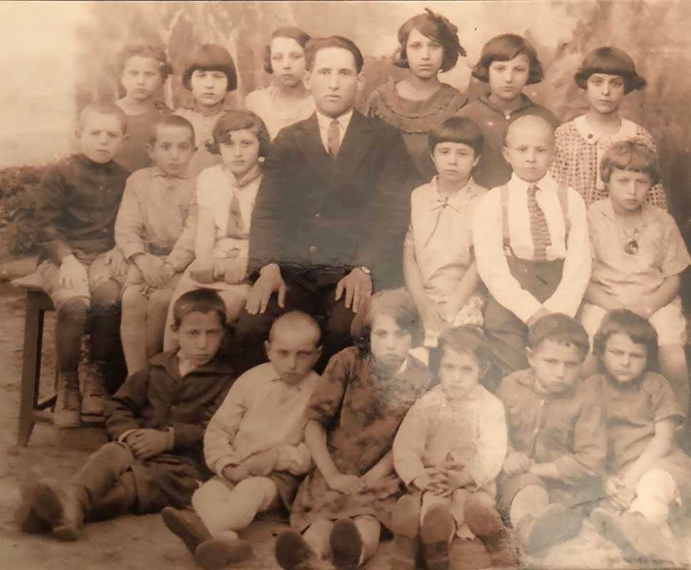 This photo shows my mother and father and their siblings in their classroom in Lithuania. My parents are both in the picture, as they were next door neighbors since childhood. They met again after the war, and were the sole survivors of their town in Lithuania.